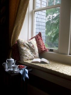 Rainy day,hot tea and a book with comfortable pillows and a view. Heaven