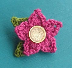 Pointy Petal Flower | Crochet with Raymond.  Works up nice. Used G hook and sparkle Party Caron Yarn!!