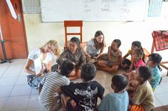 Volunteers Marla and Suzie are teaching English at program Ubud. They are reading a story in a circle. #readingday