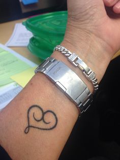 Mother/son tattoo shaped into a heart.                                                                                                                                                      More