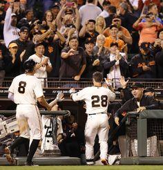 San Francisco Giants' Buster Posey (28) is congratulated after hitting a two-run home run off Colorado Rockies' Jorge De La Rosa in the sixth inning of a baseball game Tuesday, Aug. 26, 2014, in San Francisco. (AP Photo/Ben Margot)