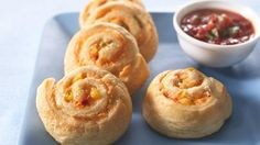 "Nacho Pinwheels - Classic Mexican snack flavors are rolled up in a flaky crescent appetizer that will ""wow"" guests of any age!"