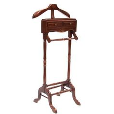 Our timeless gentleman's valet stand remains an essential piece of furniture. A place for a jacket, pants and shoes along with small storage draws for loose change, cufflinks or a wallet. Made from solid Mahogany with hand carved detail.