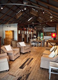 love the tin on the walls combined with the rustic wood floors, shabby chic furniture, and modern accents