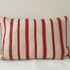Cushion covers from vintage ticking Backed with a plain vintage linen Wooden button fastening 3 available To fit with 65 x 45 cm filler Ticking Fabric, Linen Fabric, Red Pillows, Throw Pillows, Red Plum, Grain Sack, Ticks, Cushion Covers, Upholstery