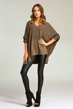 If you want comfy and cute, this is the sweater for you. Looks amazing over leggings or a skinny jean. V-neck, poncho style top. Super soft Model is wearing a small 76% rayon 21% polyester 3% spandex