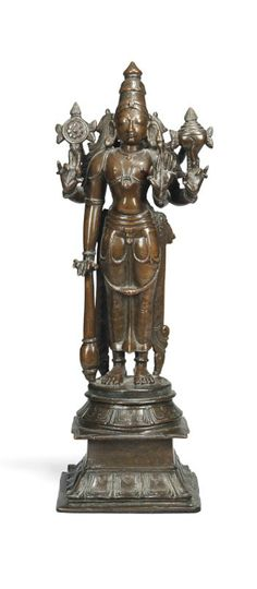 A BRONZE FIGURE OF VISNU  SOUTH INDIA, 17TH CENTURY  Standing on rounded base supported by a tall square pedestal, holding his attributes and wearing a tiara, good condition 15 1/8in. (38.5cm.) high.