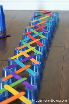 Remove the first cup & they start falling in a domino effect: 4 Engineering Challenges for Kids - with Cups, Craft Sticks, and Cubes. Fun for rainy days!!