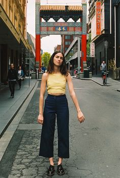 Yellow sleeveless top (with white trim from monki) with navy culottes and white superga?