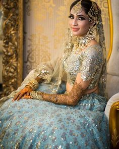 Mesmerized with the bride's Sangeet look💞 Her flawless makeup, stunning jewellery, & her beautiful lehenga is making her a radiant bride. Makeup: Hair : Photography by Outfit by . Wedding Lehanga, Bridal Lehenga, Sangeet Outfit, Blue Lehenga, Wear Store, Blue Bridal, Flawless Makeup, Bridal Photography, Bridal Portraits