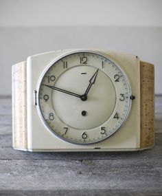 Vintage creme enamel clock for your collection!