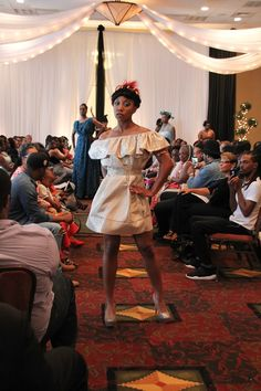 Gold Gatsby Dress by Jan King Designs. 2016 Beauty and Brains Fashion Show Nashville, TN - TwoSistersPhoto Jan King Designs Black Rose Skirt and Halter top with feather headpiece. 2016 Jan King Designs.Beauty and Brains - TwoSistersPhoto