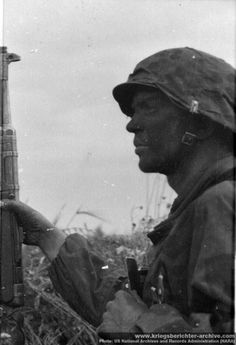 A Nazi with his K98 bolt-action rifle, scouts an open field.