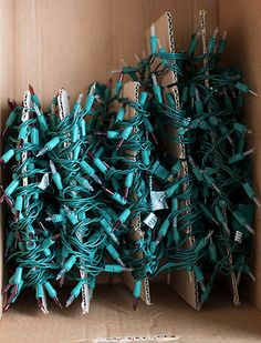 keep your christmas lights from getting tangled by wrapping them around sheets of cardboard christmas tree
