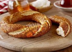 Simit is a circle shaped bread that can consider as Turkish fast food. I said fast food because you can find Simit almost in every corner of city centers in Turkey. Turkish Simit Recipe, Turkish Recipes, Turkish Breakfast, Best Street Food, Low Carb Bread, International Recipes, Bagel, Great Recipes, Gourmet Desserts