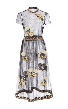 This **Red Valentino** dress features a round neck with embroidered detailing, short sleeves, an embroidered waistband creating an A-line silhoutte, wool yarn floral embroidery thourhgout, and a midi length.