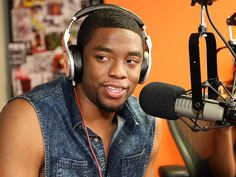 Star Tracks: Tuesday, July 29, 2014 | TALK THE TALK | Get On Up star Chadwick Boseman mans the mic during a Monday visit to the SiriusXM studio in New York City.