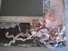 a close up of my embellishment cluster on my layout