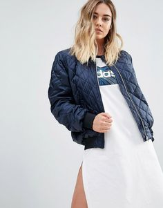 Buy it now. adidas Bomber Jacket - Navy. Bomber jacket by Adidas, Soft-touch quilted fabric, Baseball collar, Zip fastening, Functional pockets, MA1 pocket detail to sleeve, Ribbed trims, Regular fit - true to size, Machine wash, 100% Polyester, Our model wears a UK 8/EU 36/US 4 and is 168cm/5'6 tall. ABOUT ADIDAS Founded more than 60 years ago, Adidas is one of the most iconic streetwear brands in the world. Its unparalleled ability to fuse fashion and function is evident in its sleek…
