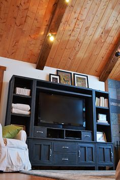 I want to make this!  DIY Furniture Plan from Ana-White.com  A beautiful media hutch to match the Cabin Collection. Features two large open shelves for controllers, two drawers for remotes, and a large shelf to customize the fit of the tv and store additional controllers, games, or books.