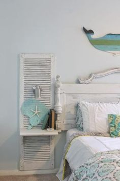 Shabby chic beAch bedroom. Awesome shutter nightstands built onto a headboard made from an old door. Sconces are mounted, and shelves added, to look like one giant custom made, and painted piece. Theraggedwren.blogspot.com by alissa