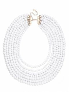 add these bright white beads to your outfit for some oomph.