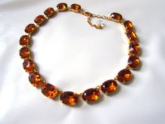 Anna Wintour Necklace Topaz Collet Necklace. by damesalamode