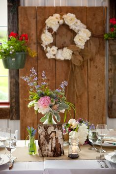 Rustic wedding reception centerpieces with DIY table numbers