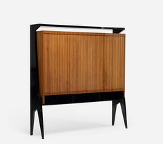So simple, so beautiful. René Prou, walnut cabinet. Check more mid-century designs clicking on the image.