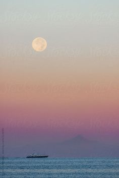 The Full Moon over a Boat in the Sea, at Sunset by Helen Sotiriadis