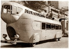 Drive Movie Bus from Crow's Nest (Modern Mechanix, 1935). UNIQUE in design is the multiple-wheeler shown below, which was designed for a film now being made at the Paramount studios. The 36-passenger vehicle is operated by a driver who sits in a glass-enclosed crow's nest jutting out from the 15-foot roof. The road liner has an oddly-shaped tail fin which extends high over the rear observation platform. The bus has four rear wheels and a circular vent in front in order to cool the radiator.""