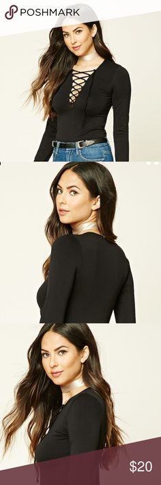 NWT F21 BLACK LONG SLEEVE LACE UP TOP Details Style Deals - A Knit Top Featuring A Plunging Lace-Up Neckline And Long Sleeves. Content + Care - 95% Nylon, 5% Spandex  - Machine Wash Cold New with tags price is firm unless bundled Forever 21 Tops Tees - Long Sleeve