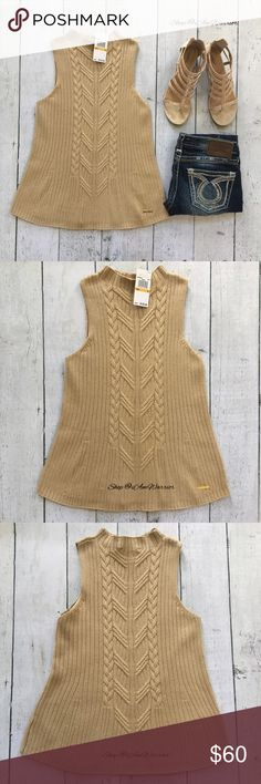 """Michael Kors NWT sleeveless cable knit sweater Such a gorgeous classic camel/khaki cable seasonless sweater from Michael Kors in a sleeveless higher neck style. Has a slight fare for a flattering fit. The perfect wardrobe piece for transitional months. Looks great with demin or dressed up. Retailed at $120 and sold out everywhere! Color varies in different lighting. Laying flat approx 25"""" long, 15.5"""" across bust. Please read updated bio regarding closet policies prior to any inquires…"""