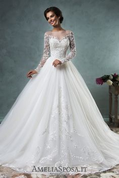 Wedding dress Sierra - AmeliaSposa.  Be a queen! This traditional silhouette exudes dignity. A bouffant skirt with ceremonial train; a delicate bustier embroidered with massive lace; a transparent, but closed back and long sleeves make this dress worth to be worn by royal persons.