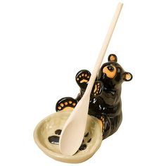 Where do you put your spoon when you're cooking? Take it off the dirty counter and put in on this cute black bear spoon holder. This creative piece of functional decor is a wonderful addition to your