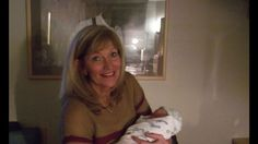 Look behind her.. Good ghost photo.. Perhaps momma's dad, or grand dad.. Looking down upon her newborn baby. !