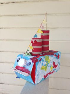Handmade milk carton boat. Great project for toddlers.