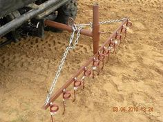 Rake by  -- Homemade rake constructed from surplus pipe, angle iron, bar stock, chain, and springs. http://www.homemadetools.net/homemade-rake-3