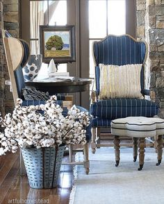 a traditional living room with navy & white striped sofas and blue