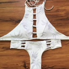WHITE TREE BRAZILIAN BIKINI For the set. Padded. Size Large: both top and bottom. Top says it fits C-D cups and bottoms size 6-8. not acacia brand acacia swimwear Swim Bikinis