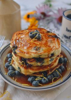 Blueberry Pancakes covered in farm fresh blueberries is a great way to enjoy blueberry season and we made it easy by sharing our time tested family recipe. This is the best blueberry pancakes recipe we've had! Brunch Recipes, Breakfast Recipes, Pancake Recipes, Crepe Recipes, Waffle Recipes, Blueberry Recipes, Lemon Blueberry Pancakes, Pancakes And Waffles, Breakfast Time