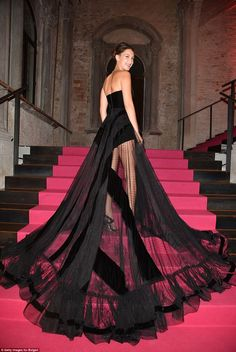 Quite the entrance! Bella looked resplendent as she showed off the dramatic skirt which fe...