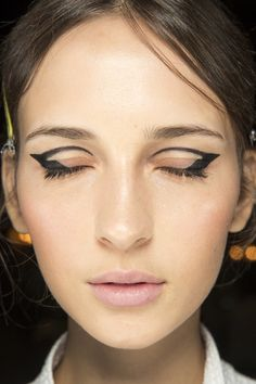 Close up of the black winged eyeliner and crease definition make up look from Oscar de la Renta's Fall 2016 Ready-to-Wear Fashion Show #runwaybeauty...x
