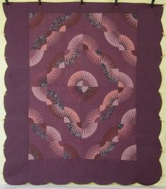 (http://www.amishquilter.com/kaleidoscope-fan-star-patchwork-amish-quilt-101x115/)