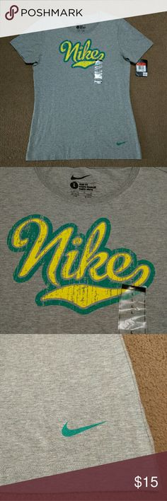 *New* Nike Slim Fit Shirt - Large Brand new with tags Nike slim fit t-shirt. Women's size large. Super cute gray shirt with yellow/turquoise Nike logo. Nike Tops Tees - Long Sleeve