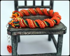 Orange You Glad Beaded Cellini Spiral Anklet or Bracelet. $45.00, via Etsy.