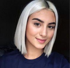 Short bob haircut and platinum blonde hair color