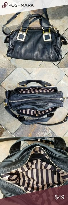 "Kelsi Dagger Black Leather satchel Purse Very nice heavy bag.  Gold hardware does have surface stratches, other than that there is no wear on this purse. Handle drop is 6"". Adjustable/ removable shoulder strap is 20 - 26"". 13 x 9 x 4"" approximately. Interior pockets plus exterior pockets. Kelsi Dagger Bags Satchels"