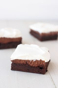 Chocolate Cream Pie Brownies - a layer of ultra fudgey brownies, followed by a rich, creamy chocolate pie filling and topped off with fluffy whipped cream. A chocolate lovers dream!