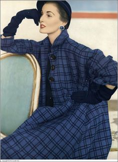 Elise Daniels in bold blue wool coat crossed with black, narrow-shouldered, flared with deep-cut sleeves by Junior Sophisticates, photo by Horst, Vogue, September 15, 1951